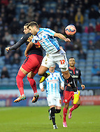 Tommy Smith of Huddersfield Town goes up for the ball with Hal Robson-Kanu of Reading during the FA Cup match at the John Smiths Stadium, Huddersfield<br /> Picture by Graham Crowther/Focus Images Ltd +44 7763 140036<br /> 03/01/2015