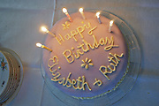 Birthday cake with candles for Elizabeth and Ruth
