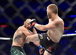 "November 3, 2018 - New York, New York, U.S. - Shane ""Hurricane"" Burgos (red gloves) vs. Kurt Holobaugh (blue gloves) during UFC 230 at Madison Square Garden. (Credit Image: © Jason Silva via ZUMA Wire)"