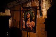 A portrait of Jesus hangs in a home in the Stara Gazela settlement.