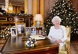 Embargoed to 0200 GMT Monday December 25, 2017 Queen Elizabeth II sits at a desk in the 1844 Room at Buckingham Palace, London, after recording her Christmas Day broadcast to the Commonwealth.
