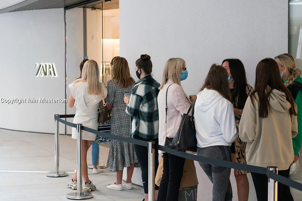 Edinburgh, Scotland, UK. 24 June 2021. First images of the new St James Quarter which opened this morning in Edinburgh. The large retail and residential complex replaced the St James Centre which occupied the site for many years. Pic; Queue of shoppers outside Zara store.  Iain Masterton/Alamy Live News