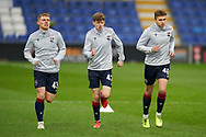 Josh red, Adam Mackinnon and Ben Wimmialson warm up before Scottish Premiership match between Ross County FC and St Johnstone FC at the Global Energy Stadium, Dingwall, Scotland on 2 January 2021