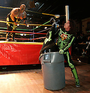 In a move that defies the laws of physics, La Super Parka stuffs one of the Headhunters into a plastic trash can.