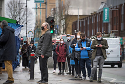 © Licensed to London News Pictures. 02/02/2021. London, UK. Member of the public queue on Broadway in West Ealing as they wait to enter a new Variant Testing Centre, set up after the discovery of a new South African variant of coronavirus. Door-to-door delivery of free home test kits is to start in the area in an attempt to slow the spread of the more aggressive strain of the virus. Photo credit: Ben Cawthra/LNP