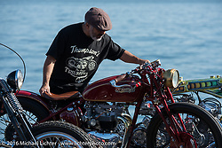 Skateboarding legend Steve Caballero with his Bryan Thompson (Thompson Cycle) built 1952 Pre-unit custom Triumph at the Yokohama docks where bikes from invited USA custom builders were unloaded prior to the Mooneyes Yokohama Hot Rod & Custom Show. Yokohama, Japan. December 3, 2016.  Photography ©2016 Michael Lichter.