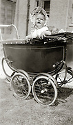 baby in stroller placed outside in the sun 1947