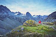 A view of the Talkeetna Mountains and the Mint Hut near Palmer, Alaska.