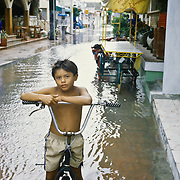 Portrait of boy with bicycle