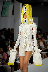 © Licensed to London News Pictures. 06/06/2018. LONDON, UK.  A model presents a look by Jacaranda Brain from Nottingham Trent University at the Best of Graduate Fashion Week 2018 show at the Old Truman Brewery in East London. The event presents the graduation show of up and coming fashion designers from UK and international universities.  Photo credit: Stephen Chung/LNP