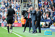 Sunderland's manager Paolo Di Canio (l) makes a point as WBA manager Steve Clarke looks on. Barclays Premier league match, West Bromwich Albion v Sunderland at the Hawthorns in West Bromwich, England on Sat 21st Sept 2013. pic by Andrew Orchard, Andrew Orchard sports photography,