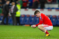 CARDIFF, WALES - Monday, October 9, 2017: Wales' Ben Woodburn looks dejected after the final whistle in the 2018 FIFA World Cup Qualifying Group D match between Wales and Republic of Ireland at the Cardiff City Stadium. (Pic by Paul Greenwood/Propaganda)