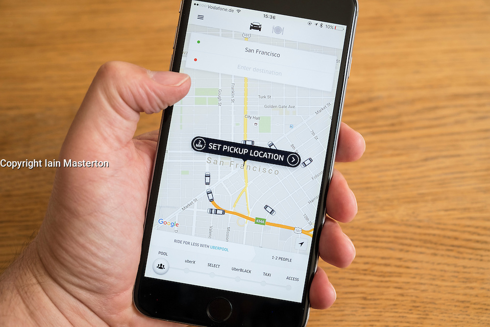 Uber taxi booking app showing San Francisco on iPhone 6 smart phone