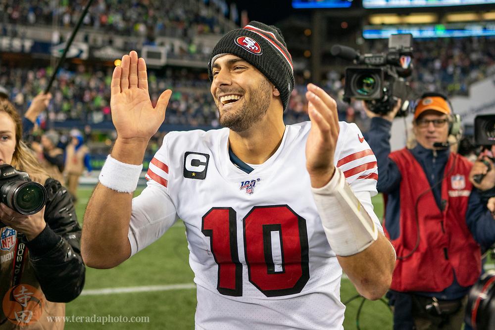 December 29, 2019; Seattle, Washington, USA; San Francisco 49ers quarterback Jimmy Garoppolo (10) celebrates after the game against the Seattle Seahawks at CenturyLink Field.