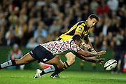 Kurtley Beale beats Tamati Ellison to the try<br /> Super 14 rugby union match, Waratahs vs Hurricanes, Sydney, Australia. <br /> Saturday 14 May 2010. Photo: Paul Seiser/PHOTOSPORT