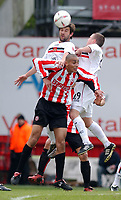 Photo: Daniel Hambury, Digitalsport<br /> Brentford V Bristol City.<br /> Coca Cola League One.<br /> 09/04/2005.<br /> Brentford's Darren Pratley is beaten to the ball by Bristol City's Tommy Doherty and Steve Brooker.