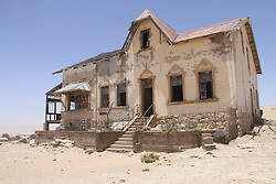 WINDHOEK, Nov. 25, 2013  Photo taken on Nov. 23, 2013 shows an abandoned building in ''Ghost Town'' Kolmanskop, Namibia. Kolmanskop is a ghost town in the Namib desert in southern Namibia. In 1908 a diamond was found in this area, which led to a huge and frantic diamond rush by German settlers. Driven by the enormous wealth of the first diamond miners, the residents built the village in the architectural style of a German town, with amenities and institutions including a hospital, ballroom, school, casino and even an x-ray-station. The town declined after World War I when the diamond field slowly exhausted and was ultimately abandoned in 1954. Now it is a popular tourist destination. (Xinhua/Gao Lei) (Credit Image: å© Gao Lei/Xinhua/ZUMAPRESS.com)