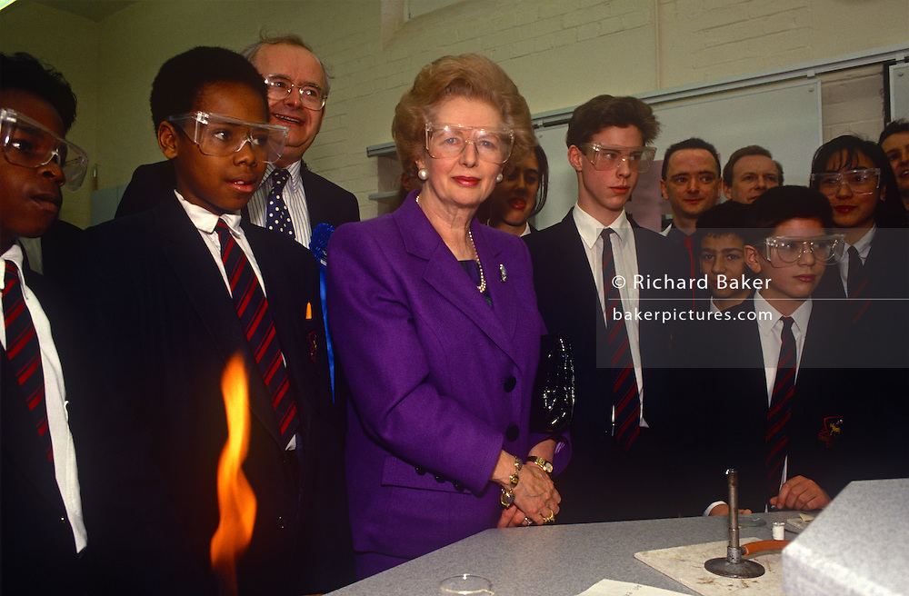 While campaigning during John Major's election campaign, ex-Prime Minister Margaret Thatcher visits a chemistry class at a north London school on 1st March 1992 in London, England. Originally a research chemist before becoming a barrister, Thatcher was elected Member of Parliament for Finchley in 1959. Her political career was over in 1990 after a leadership challenge and she died in 2013.