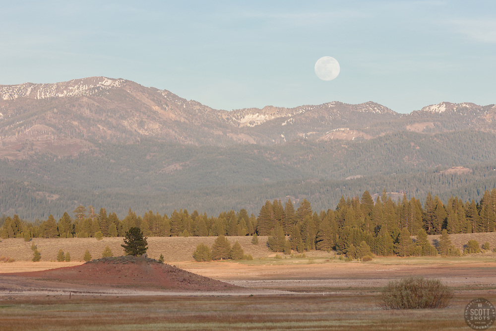 """""""Full Moon Over Prosser 1"""" - Photograph of a full moon rising over the mountains at a very low Prosser Reservoir near Truckee, California."""