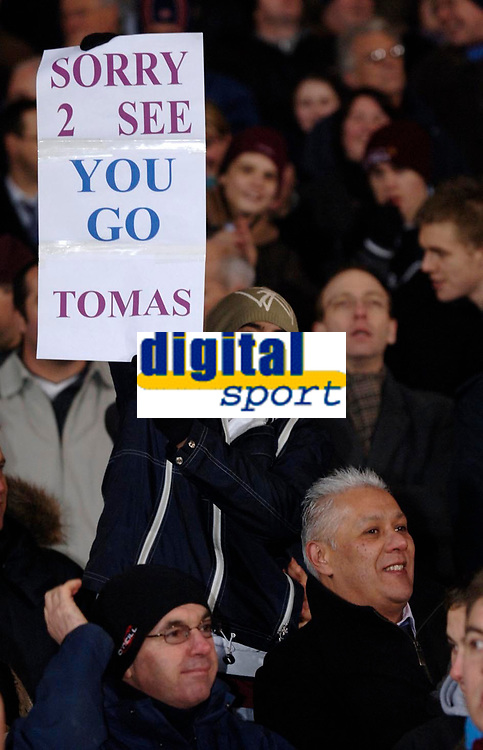 Photo: Daniel Hambury.<br />West Ham United v Fulham. The Barclays Premiership. 23/01/2006.<br />A West Ham fan with a sign for Tomas Repka who makes his last appearence for the club.