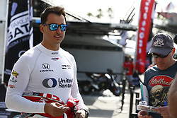 April 13, 2018 - Long Beach, California, United States of America - April 13, 2018 - Long Beach, California, USA: Graham Rahal (15) takes photos and signs a few autographs for fans in the Verizon IndyCar Series Paddock prior to practice for the Toyota Grand Prix of Long Beach at Streets of Long Beach in Long Beach, California. (Credit Image: © Justin R. Noe Asp Inc/ASP via ZUMA Wire)