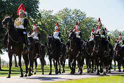 Windsor, UK. 9th June, 2021. The Household Cavalry Mounted Regiment arrives on the Long Walk in Windsor Great Park for a dress rehearsal at Windsor Castle of Trooping the Colour. A socially distanced and scaled down Trooping the Colour ceremony to mark the Queen's birthday will take place at Windsor Castle on 12th June incorporating many of the elements from the annual ceremonial parade on Horse Guards, with F Company Scots Guards Trooping the Colour of the 2nd Battalion Scots Guards in the Castle Quadrangle.