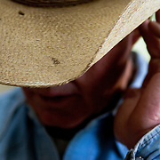 Round Valley rancher Sam Udall readies for a days work on the X-Diamond Ranch with owner, Wink Crigler.  Crigler's X Diamond Ranch is one of several operations that are incorporating river ecology and watershed management into their work along the Little Colorado.  You need water to ranch and if you want to keep the water around, you have to be careful the way you ranch.