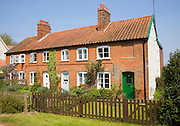 Pretty row of terraced cottages at Bawdsey, Suffolk, England