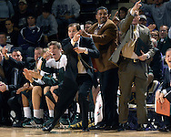 Baylor head coach Scott Drew (C) points down court, letting the officials know which way the ball should go, during the first half against Kansas State at Bramlage Coliseum in Manhattan, Kansas, January 17, 2007. K-State beat Baylor 69-60.