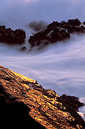 Sunset light on coastal rocks and surf, Stillwater Cove Regional Park, Sonoma Coast, California