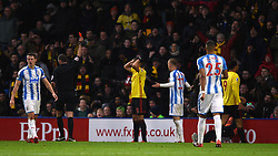 Watford's Troy Deeney (right) is shown a red card during the Premier League match at Vicarage Road, Watford.
