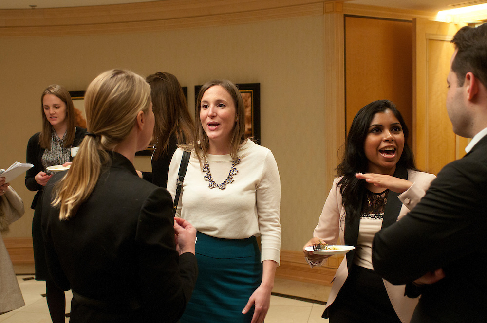 """Shefsky & Froelich Associate Attorney Rachel L. Schaller (center) chats with firm Partner Heather A. Jackson (back to camera) while Loyola University law student Nidhi Srivastava (right center) talks with Shefsky Associate Attorney Jonathan B. Amarilo (right) during a reception before a Women's Bar Association of Illinois panel discussion titled """"The Male Perspective:  Make Me Your Mentor"""" on Tuesday, January 8th. © 2013 Brian J. Morowczynski ViaPhotos"""