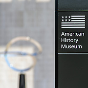 Smithsonian National Museum of American History Sign Entrance. A sign outside the Mall entrance of the Smithsonian National Museum of American History in Washington DC. These signs have recently been erected by the National Park Service as a new way to provide directions around the Mall.