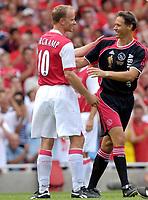 Photo: Daniel Hambury.<br />Arsenal v Ajax. Dennis Bergkamp Testimonial. 22/07/2006.<br />Arsenal's Dennis Bergkamp and Dutch national coach Marco van Basten.
