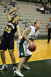 18 December 2004..Angie Carr catches her balance while trying to find a way to defend an inevitable shot by Katie Blonn..Illinois Wesleyan University Titans V Webster University Gorlocks.  NCAA Division III Women's Basketball.  Shirk Center, Illinois Wesleyan University, Bloomington IL