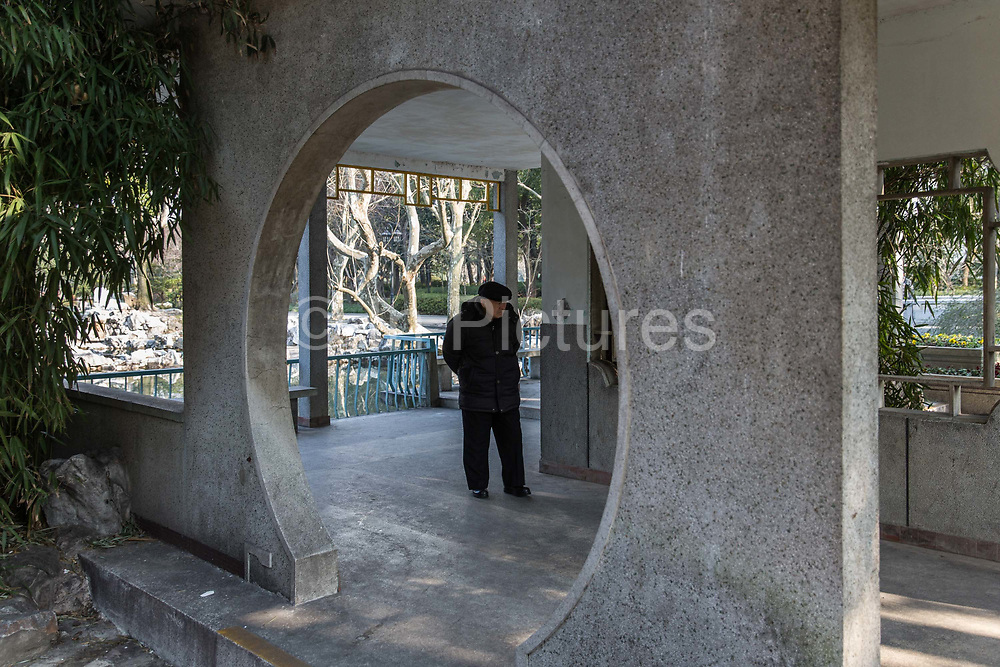 A visitor walks through Fuxing Park in Shanghai, China, on Feb. 6, 2016.