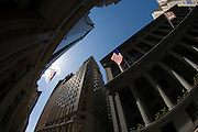 Distorted fish-eye lens view of banking and financial institutions on Wall Street, Lower Manhattan, New York City.