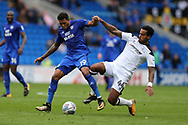 Nathaniel Mendez-Laing of Cardiff city is tackled by Tom Huddlestone of Derby county ®. EFL Skybet championship match, Cardiff city v Derby County at the Cardiff city stadium in Cardiff, South Wales on Saturday 30th September 2017.<br /> pic by Andrew Orchard, Andrew Orchard sports photography.