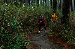 January 19, 2019 - Southern Pines, North Carolina, US - Jan. 19, 2019 - Southern Pines N.C., USA - Douglas Failla, Columbia, South Carolina, and Glen Failla, Portland, Oregon complete a lap during the 10th Annual Weymouth Woods 100km ultra marathon at the Weymouth Woods Nature Preserve. Runners needed to complete 14 laps of the 4.47 mile course for 62.58 miles in under the 20-hour time allotment. (Credit Image: © Timothy L. Hale/ZUMA Wire)