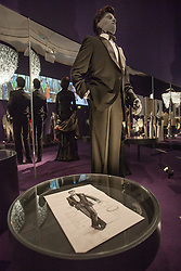 © licensed to London News Pictures. London, UK 05/07/2012. A James Bond costume being shown with many Bond items which have been used in the movies in the last 50 years at Designing 007 exhibition at Barbican Centre. Photo credit: Tolga Akmen/LNP