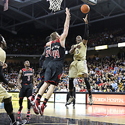UCF Knights guard Isaiah Sykes (3) shoots past Louisville Cardinals forward Stephan Van Treese (44) and Louisville Cardinals forward Montrezl Harrell (24) during an NCAA basketball game between the 14th ranked Louisville Cardinals and the UCF Knights at the CFE Arena on Tuesday, December 31, 2013 in Orlando, Florida. (AP Photo/Alex Menendez)