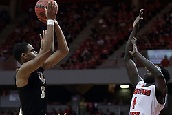 """20 March 2017:  A.J. Davis shoots over Daouda """"David"""" Ndiaye (4) during a College NIT (National Invitational Tournament) 2nd round mens basketball game between the UCF (University of Central Florida) Knights and Illinois State Redbirds in  Redbird Arena, Normal IL"""