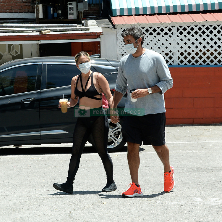 EXCLUSIVE: Singer Lady Gaga and boyfriend Michael Polansky hold hands as they grab morning coffee in Hollywood. 30 May 2020 Pictured: Lady Gaga; Michael Polansky. Photo credit: MEGA TheMegaAgency.com +1 888 505 6342