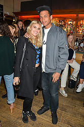 TIGERLILY TAYLOR and HENRY PEDRO-WRIGHT at a quiz night hosted by Zoe Jordan to celebrate the launch of her men's ZJKNITLAB collection held at The Larrick Pub, 32 Crawford Place, London on 20th April 2016.