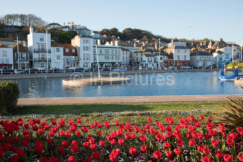 A seaside boating lake overlooking Hastings old town on the 20th April 2019 in Hastings in the United Kingdom. Hastings is a town on England's southeast coast, its known for the 1066 Battle of Hastings.