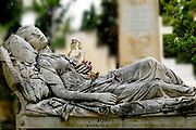 Reclining woman statue in a cemetery, Athens, Greece