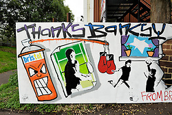 "© Licensed to London News Pictures. 27/08/2014; Bristol, UK.  A 'Thanks Banksy"" sign by the Broad Plain Working With Young People club by the M32 in Bristol.  The Banksy piece 'Mobile Lovers' has been sold for £403,000 by Mary McCarthy of MM Contemporary Arts to a private buyer on behalf of the club.  The artwork was placed near to the Riverside Project at the Broad Plain club run by Dennis Stinchcombe MBE.  There was a dispute between Denis and the Mayor of Bristol George Ferguson over the ownership of the artwork which was resolved when Banksy sent a letter to the club saying the artwork was theirs to do with what they wished.  The money from the sale will help fund the continuing activities of the club.<br /> Photo credit: Simon Chapman/LNP"