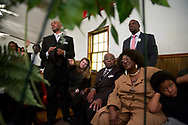 Family members listen on as a song is passionately sung at Billy Joe Jenkins funeral service in Cleveland, Georgia.