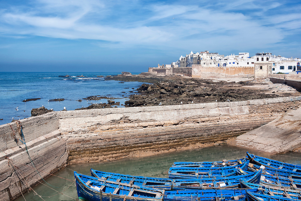Coastal town Essaouira with sea and blue boats.