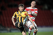 Matthew Kennedy (Port Vale) calmly kicks the ball up and over his head to then clear from Richard Chaplow (Doncaster Rovers) during the Sky Bet League 1 match between Doncaster Rovers and Port Vale at the Keepmoat Stadium, Doncaster, England on 26 January 2016. Photo by Mark P Doherty.